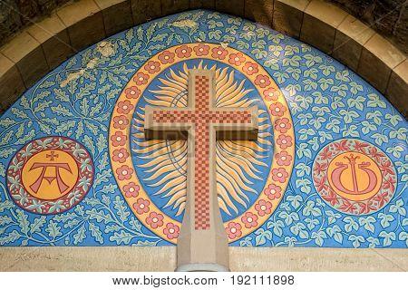 A Roman Catholic cross over the entrance of a church