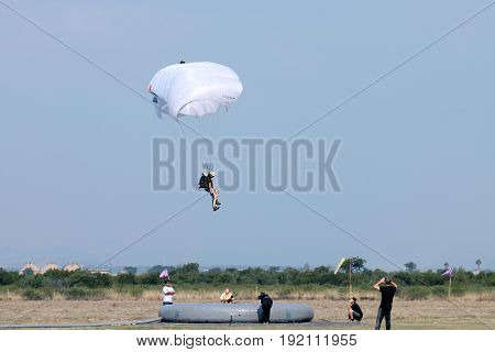 Jumper With White Open Parachute Performing Classic Accuracy Landing.