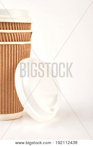 Image of paper coffee container. Take out coffee in thermo cup.