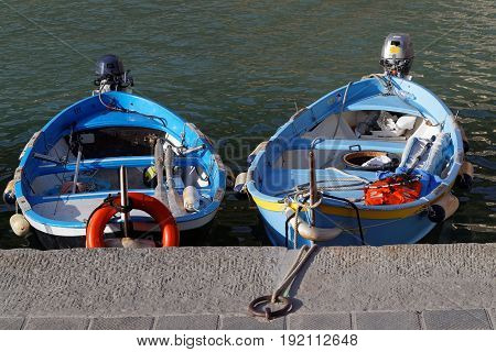 VERNAZZA Italy June 4 2017 : Two small boats in the harbor of Vernazza a village of the Cinque Terre National Park on the Italian Riviera. The area is a very popular tourist destination and a world heritage site.