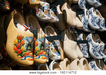 Volendam Netherlands - 26 April 2017: klomp or klompen - dutch clogs made of poplar wood traditional shoes with colorful paintings. Popular Netherlandish gift in souvenir shop.
