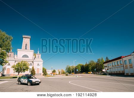 Chachersk, Belarus - May 14, 2017: Police Car Parking On Street Near Old City Hall In Sunny Summer Day. Town Hall In Chechersk