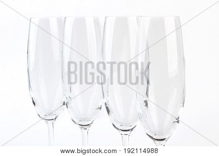 Closeup of group wineglasses. Cutted picture of goblets, white background.