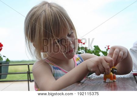 Portrait of cute young girl playing in café