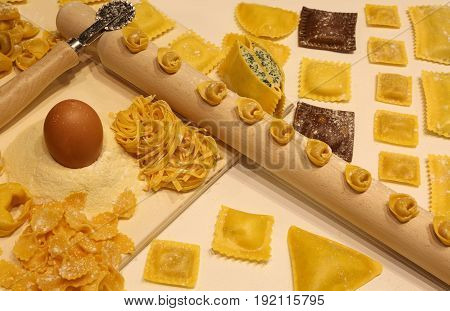 Pasta Of Many Sizes With Wooden Rolling Pin And Tortellini And R