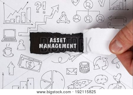Business, Technology, Internet And Network Concept. Young Businessman Shows The Word: Asset Manageme