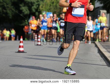 Runner Runs The Marathon On The City Street