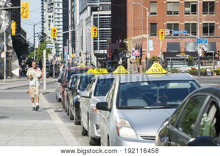TORONTO,CANADA-AUGUST 2,2015:Line of taxi waiting the tourist in the Toronto suburbs during a sunny day.