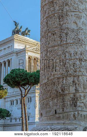 Trajan column and Vittorio Emmanuele II monument in background. Rome Italy.