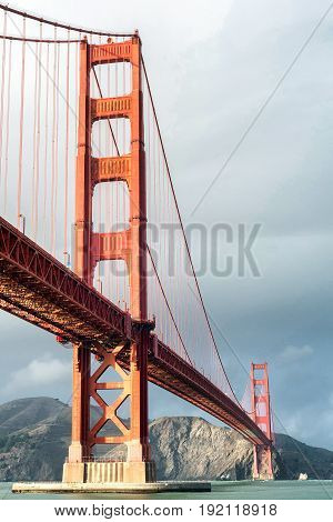 Golden Gate Bridge over San Francisco Bay on a cloudy day