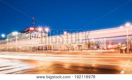 Vitebsk, Belarus - February 15, 2017: Traffic At Intersection Of Lenina Street, Zamkovaya Street And Frunze Avenue. City Center In Night Illumination At Winter Season.
