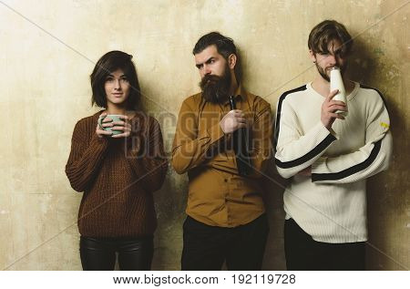 Friends With Drinks On Beige Wall.