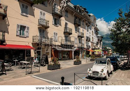 Saint-Gervais-Les-Bains, France - June 27, 2016. View of Street in the city center, with car and shops. Saint-Gervais-Les-Bains is a famous ski resort located in Haute-Savoie Province, near the Mont Blanc in the French Alps