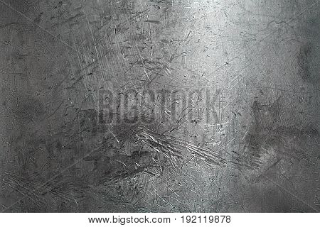 Background created by closeup of shiny metal surface revealing scratch marks from polishing the material