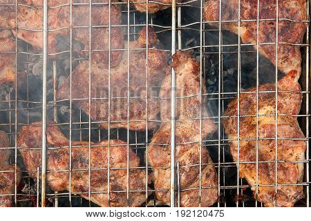 Juicy Pork Steak Cooking On An Open Flame Grill.
