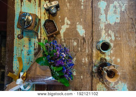 view of ground coffee pouring water on coffee ground with filter Flower and brick wall background Colour Retro style. Thailand
