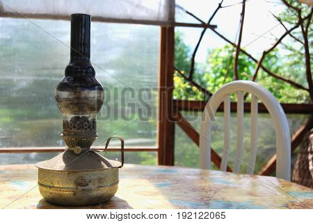 Kerosene lamp on a table in a gazebo