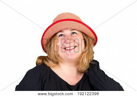 Portrait of a attractive european light overweighted red haired female playing with her read headwear, isolated on white background