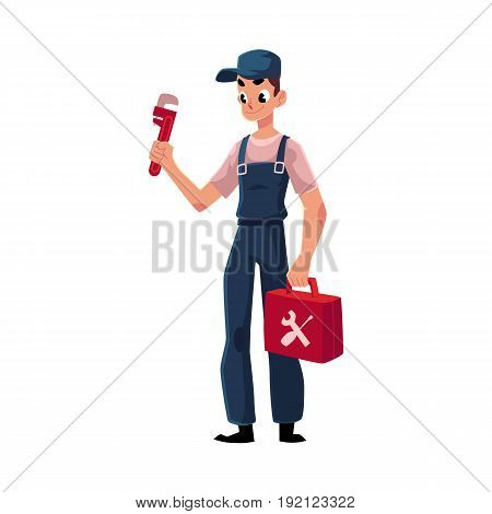 Smiling plumbing specialist, plumber standing with wrench and toolbox, cartoon vector illustration isolated on white background. Full length portrait of plumber, plumbing specialist with a toolbox