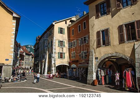 Annecy, France - June 28, 2016. Colorful street with old buildings and people in the city center of the historic Annecy, department of Haute-Savoie, Auvergne-Rhône-Alpes region, south-eastern France
