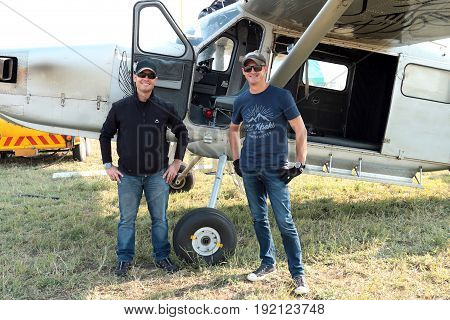 Pilots Standing Next To One Of Two X328 Atlas Angel Turbine Specially Equipped Aircraft For Sky Dive