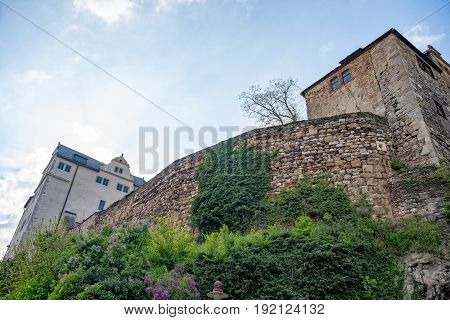 The Wall of the castle of Ranis with buildings