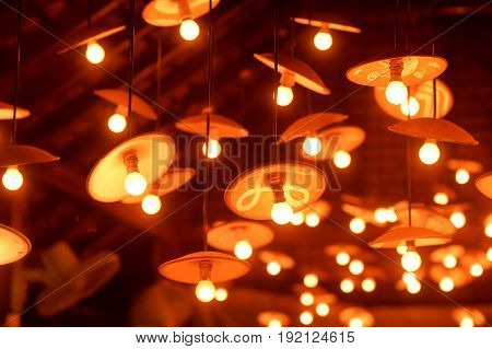 Lots of light bulbs under the ceiling background