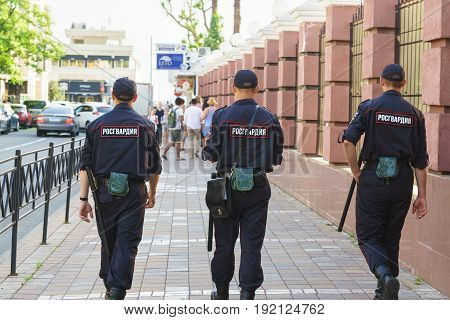 Police Patrol On A City Street On A Summer Day. Patch