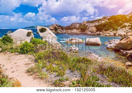 Cala Scilla place near Costa Serena with sandstone rocks in sea, Sardinia, Italy.