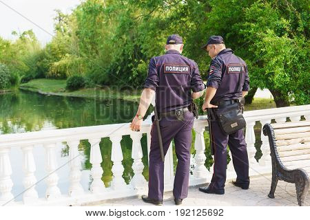 Two Police Officers Follow The Rule Of Law In The Dendrological Park