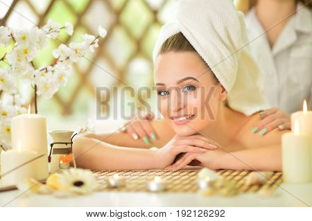 pretty young girl lying down on a massage bed at a spa