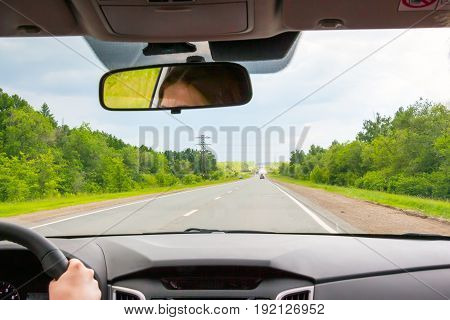 View of the road through the windshield of the car