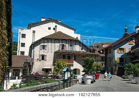 Talloires, France - June 29, 2016. View of street and houses in the village of Talloires, near the Lake of Annecy. Department of Haute-Savoie, Auvergne-Rhône-Alpes region, south-eastern France