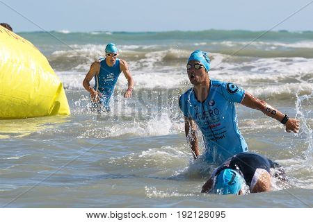 Pescara Italy - June 18 2017: Arrival of the first athletes at the end of the swimming test at Ironman 70.3 in Pescara