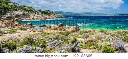 Costline of Costa Serena with sandstone rocks and sea waves, Sardinia, Italy.