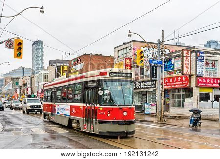 Toronto, Canada - May 2, 2017: Old streetcar in Chinatown of Toronto. The Toronto streetcar system is the largest and the busiest light-rail system in North America