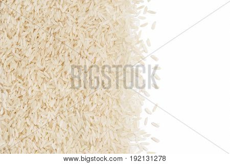 Long parboiled rice scattered on white background. Copy space. Top view high resolution product. Healthy food concep