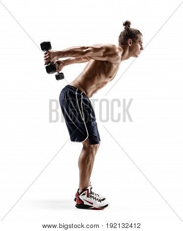 Side view. Muscular bodybuilder guy doing exercises with dumbbells. Photo of sporty male with naked torso isolated on white background. Strength and motivation.