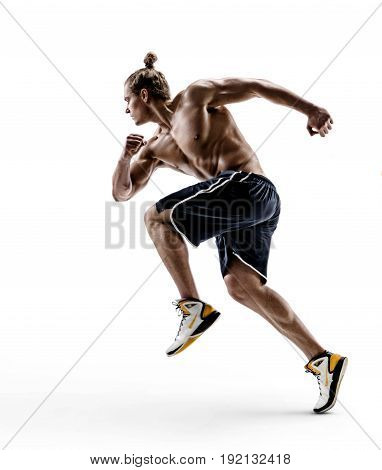 Side view of muscular man in sportswear running and exercising isolated on white background. Strength and motivation.