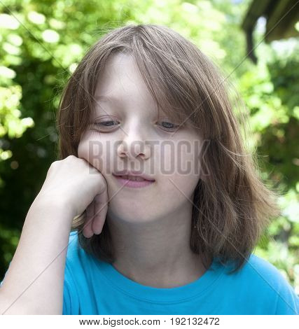 Portrait of a Boy Outdoors Looking Down