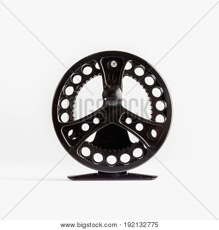 Fly Reel grey on white background. Fly reel for fly fishing. Fly reel close-up.