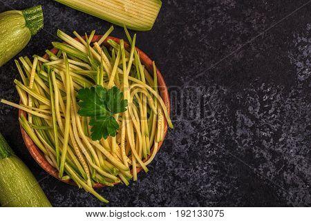 Raw Zucchini Pasta On Dark Background.
