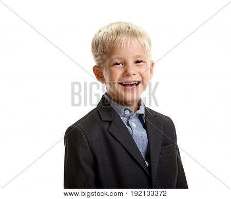 Portrait of young positive boy in school uniform laughing