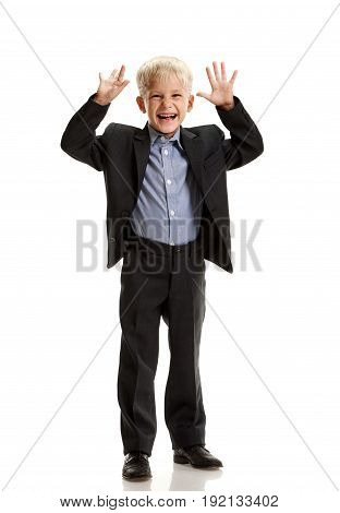 Full portrait of little joyful schoolboy laughing and teasing