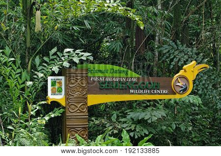 KUCHING - SARAWAK - MALAYSIA - SEPTEMBER, 2009:  Signpost-signboard of the Sarawak Forestry againts of green tropical trees. This is a leader in tropical forest conservation and products