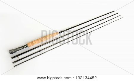 A fly fishing rod on a white background. Spinning fishing rod on white background. High resolution photo.