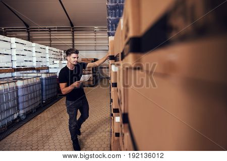 Brewery Warehouse Manager Taking Inventory
