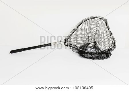 Fishing net landing net on white background