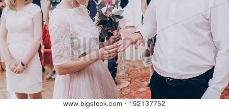 Stylish Wedding Bride And Groom Exchanging Wedding Rings.modern Couple Putting On Each Other Wedding