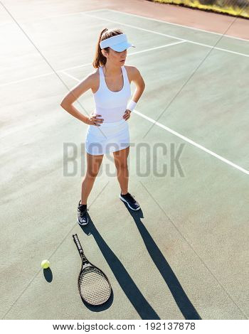 Sports Woman On Tennis Court